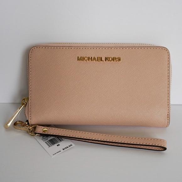 Michael Kors Handbags - Michael Kors Jet Set LG Phone Wristlet Pink Ballet